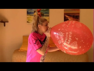 CHICK WITH BLOND HAIR BLOW PINK BALLOON TO POP  and times herself