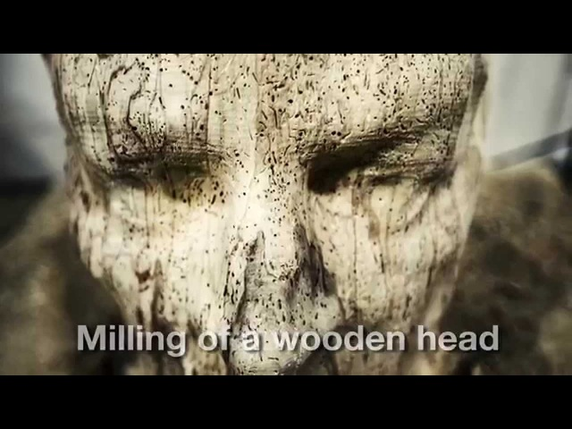 Milling of a human face on green oak using Robotmaster