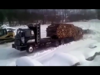 Truck driver unloading logs like a boss
