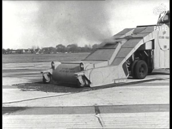Vacuum Cleaner Sweeps Airport 1957